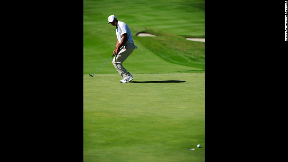 Woods misses a putt at the Frys.com Open in October 2011. That month, he dropped out of golf's top 50 for the first time in almost 15 years. Woods reportedly lost millions in endorsements after sponsors ended their ties with him in the wake of his sex scandal.