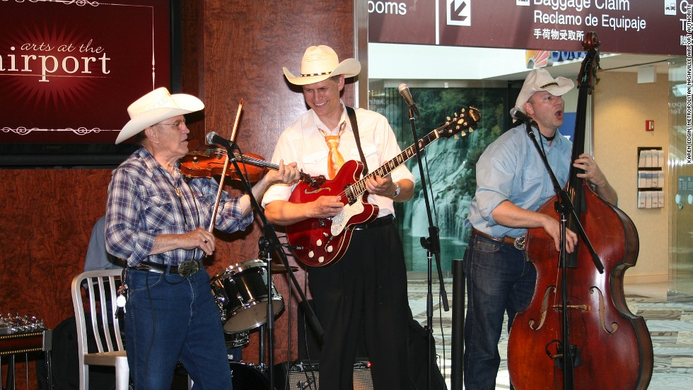 The Western Swingers band perform for travelers at Nashville International Airport. Playing on the city's rich musical heritage, the facility hosts upwards of 100 concerts every year.