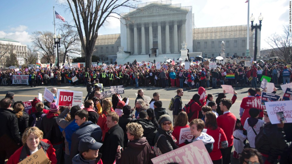 Crowds gather outside the Supreme Court on Tuesday as justices hear the first case on same-sex marriage.