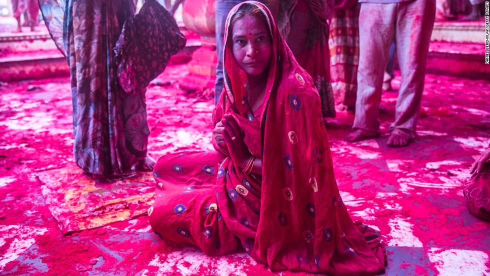 A devotee sits at the Ladli Ji temple during Lathmar Holi celebrations on March 21.