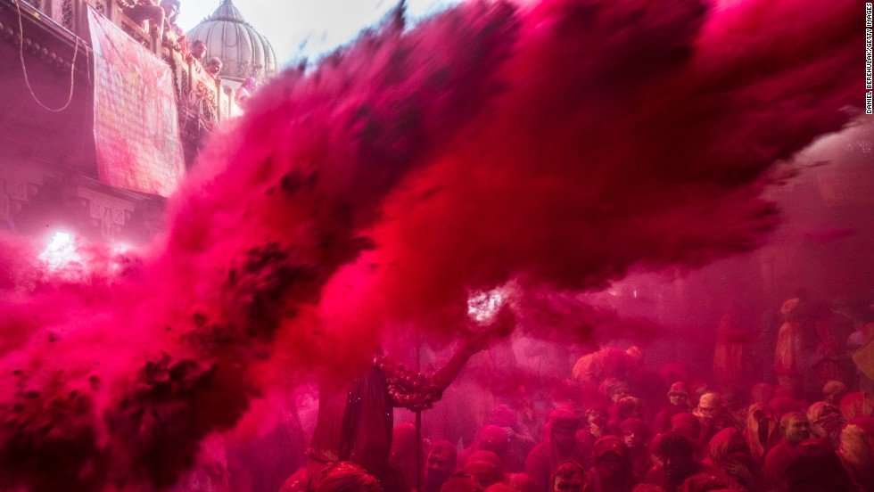 Colored powder fills the air during Lathmar Holi in Barsana on March 21.