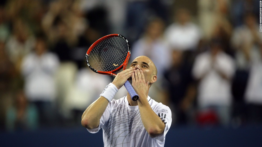 Agassi blows kisses to the crowd after winning his first round match at the 2006 U.S. Open. But he would retire from the sport at the age of 36 after losing to Germany's Benjamin Becker in the third round.