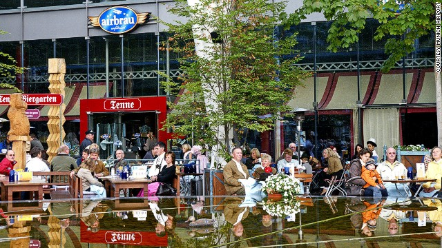 Travelers relax in Munich Airport's beer garden.