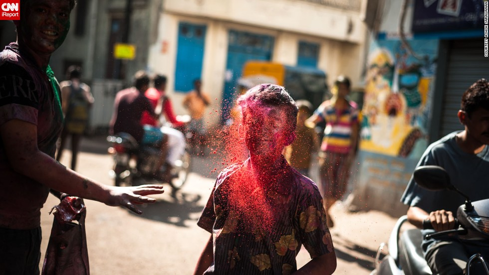 "A young boy is engulfed in red powder by a friend as Holi celebrations hit the streets of Chennai, India, in this image by <a href=""http://ireport.cnn.com/docs/DOC-947602"" target=""_blank"">iReporter Ashok Saravanan</a>."