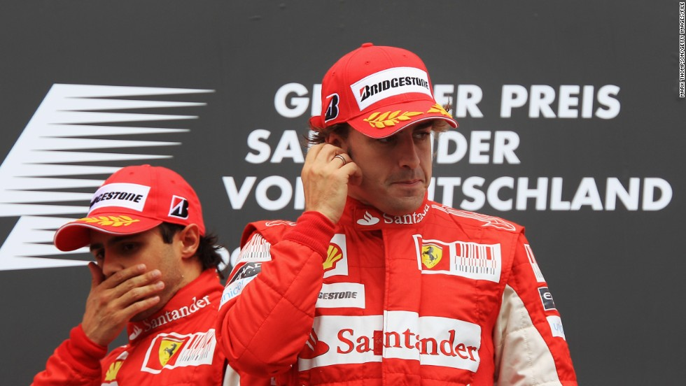 Awkward scenes on the podium at the 2010 German Grand Prix after Felipe Massa (left) surrendered the lead to his Ferrari teammate Fernando Alonso when the team told him that the Spaniard had the faster car.