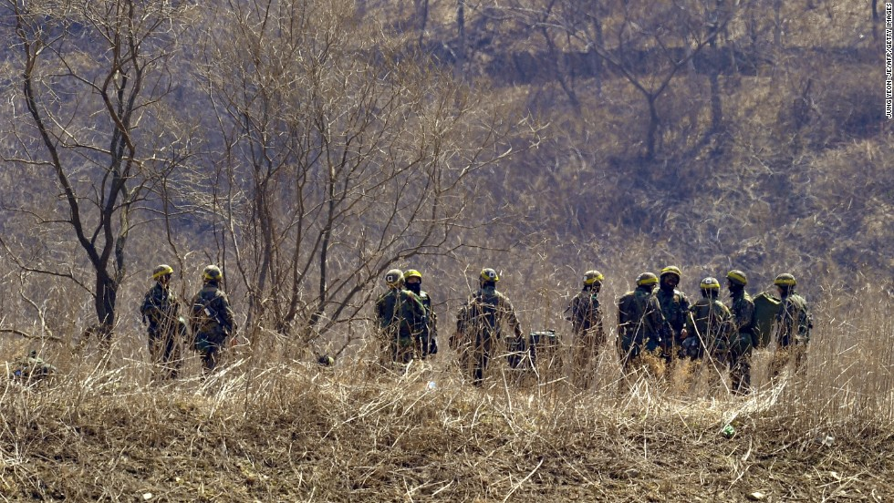 South Korean soldiers gather at the foot of a mountain near a military drill field in the border city of Paju on Wednesday, March 27.