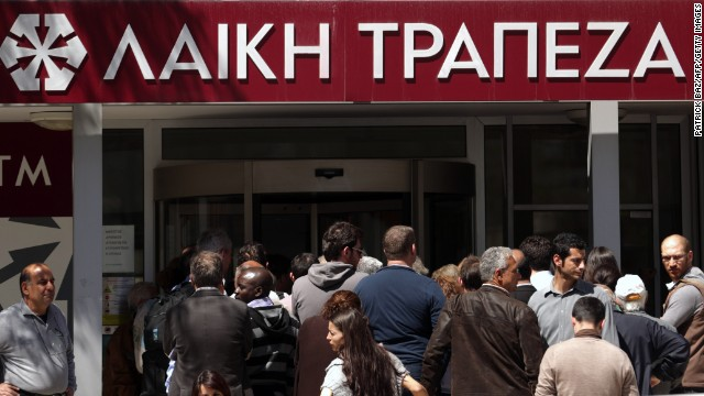 People queue up outside a Laiki bank branch in the Cypriot capital, Nicosia, on March 28.