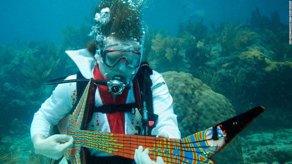 "Eric Rolfe, costumed as ""Eel-vis Presley"" strums on a fake guitar during the Lower Keys Underwater Music Festival in 2011. Check out this year's event in July."