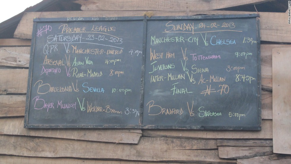 Proving football knows no bounds in Africa, even in the waterways of Makoko, a chalkboard marks viewing times for upcoming international matches. A single television powered through cables strung over structures makes viewing the matches possible.