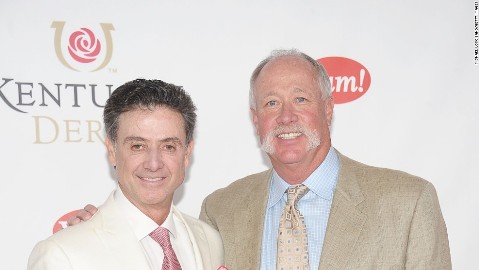 "Pitino is pictured arriving at the 2011 Kentucky Derby with former pro-baseball player Richard ""Goose"" Gossage."