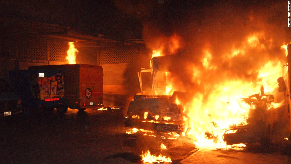 Delivery trucks from the Mexican snacks company Sabritas burn after assailants set them on fire at a warehouse in Lazaro Cardenas, in the Mexican state of Michoacan, on May 26, 2012. At least three warehouses and 28 vehicles were damaged in a series of coordinated arson attacks against the company in the towns of Lazaro Cardenas, Uruapan and Apatzingan. Drug cartel members posted banners saying the snack company let law enforcement agents use its trucks for surveillance, a charge the company denied.