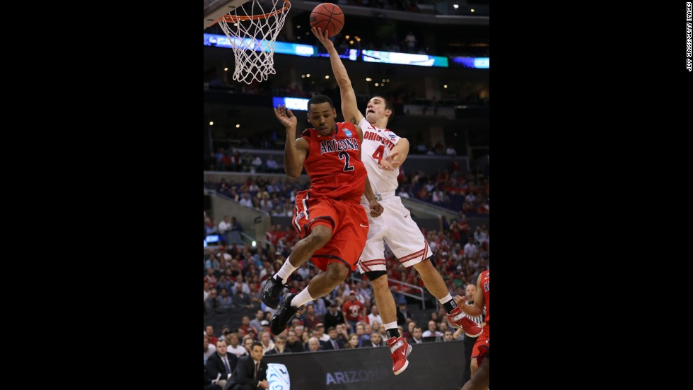 Aaron Craft of Ohio State goes up for a shot against Mark Lyons of Arizona on March 28.