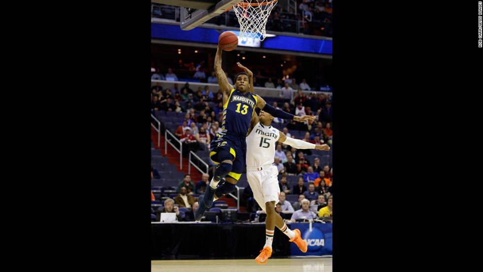 Vander Blue of Marquette goes to the hoop past Rion Brown of Miami on March 28 in Washington.