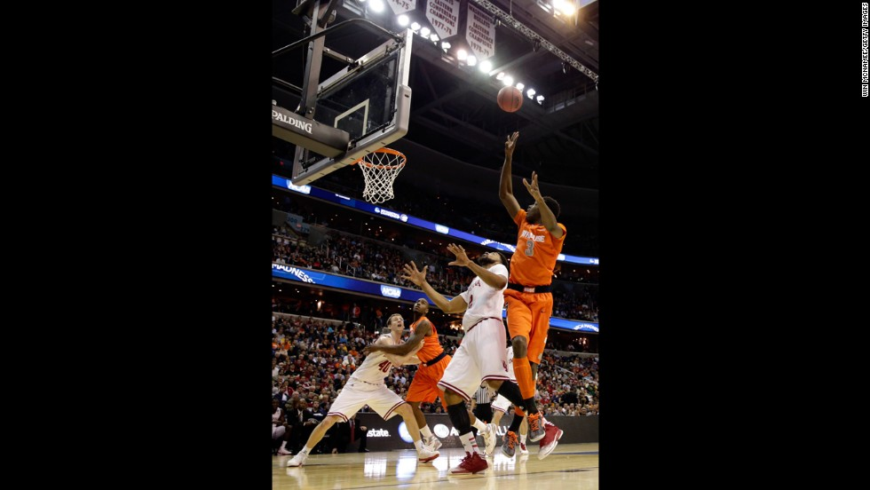 Jerami Grant of Syracuse, right, shoots the ball over Christian Watford of Indiana on March 28.