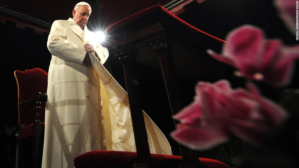 Pope Francis puts his coat on during the celebration of the Way of the Cross on Good Friday, March 29 at the Colosseum in Rome.
