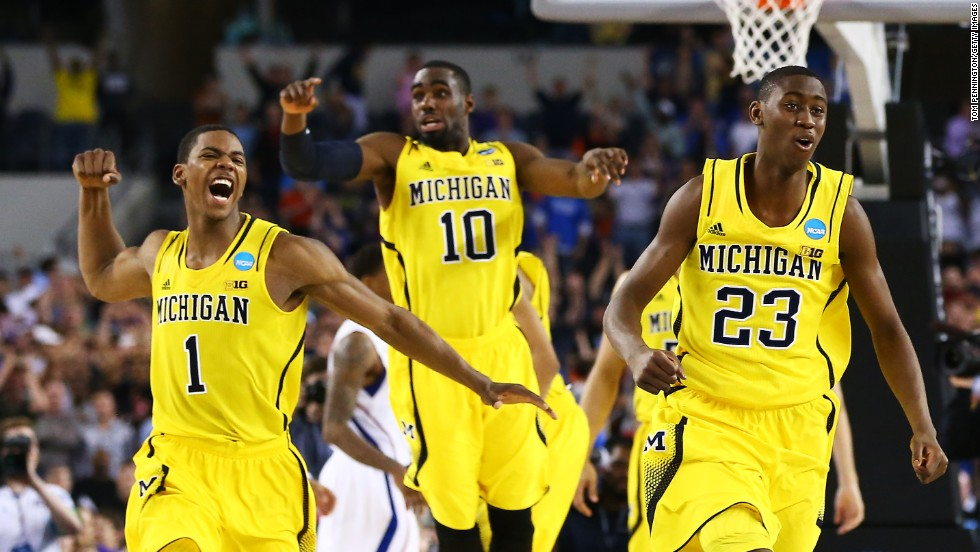 From left, Glenn Robinson III, Tim Hardaway Jr. and Caris LeVert of Michigan celebrate their 87-85 overtime win over Kansas on March 29.