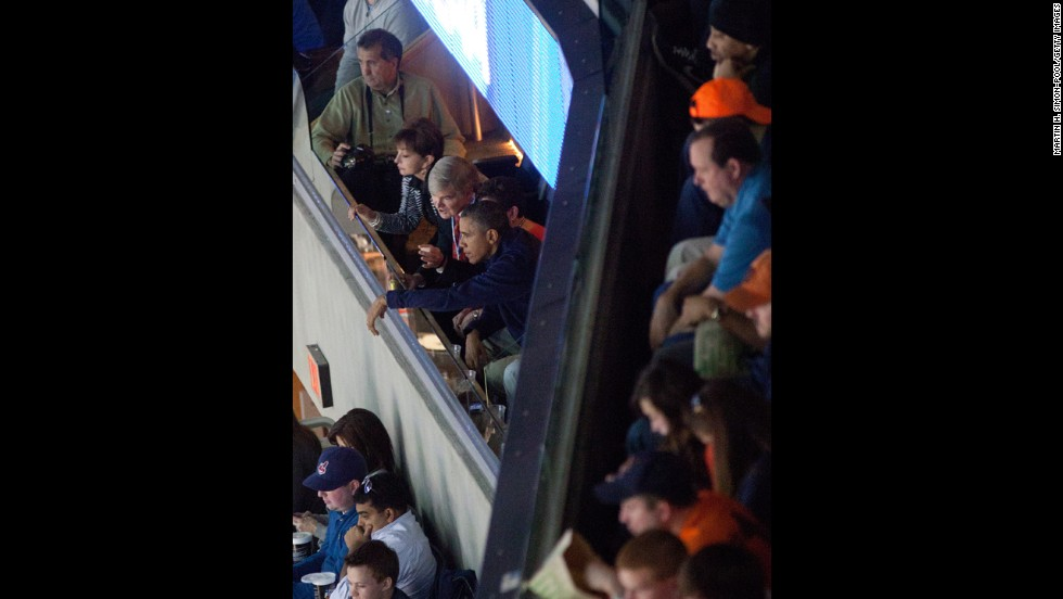 President Barack Obama watches Syracuse take on Marquette on March 30.