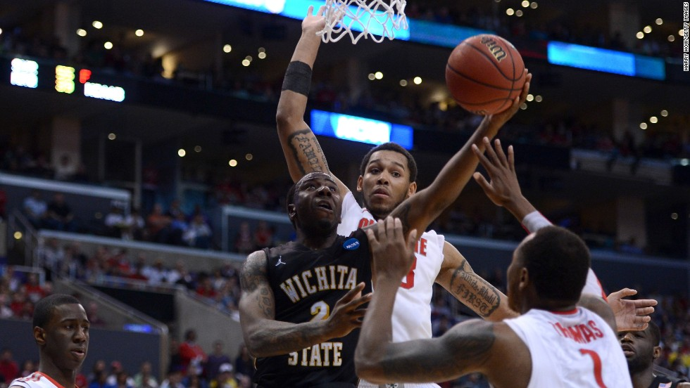 Malcolm Armstead of Wichita State goes up for a shot against Deshaun Thomas, center, and Amir Williams of Ohio State on March 30.