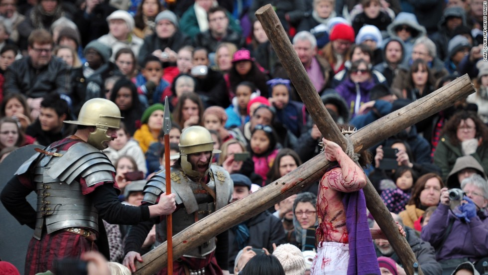 An actor playing Jesus carries a cross during the performance in Trafalgar Square in London on Friday.