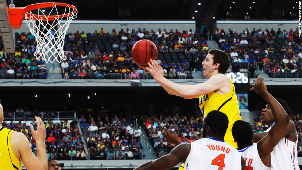 Nik Stauskas of Michigan shoots over Florida on March 31.