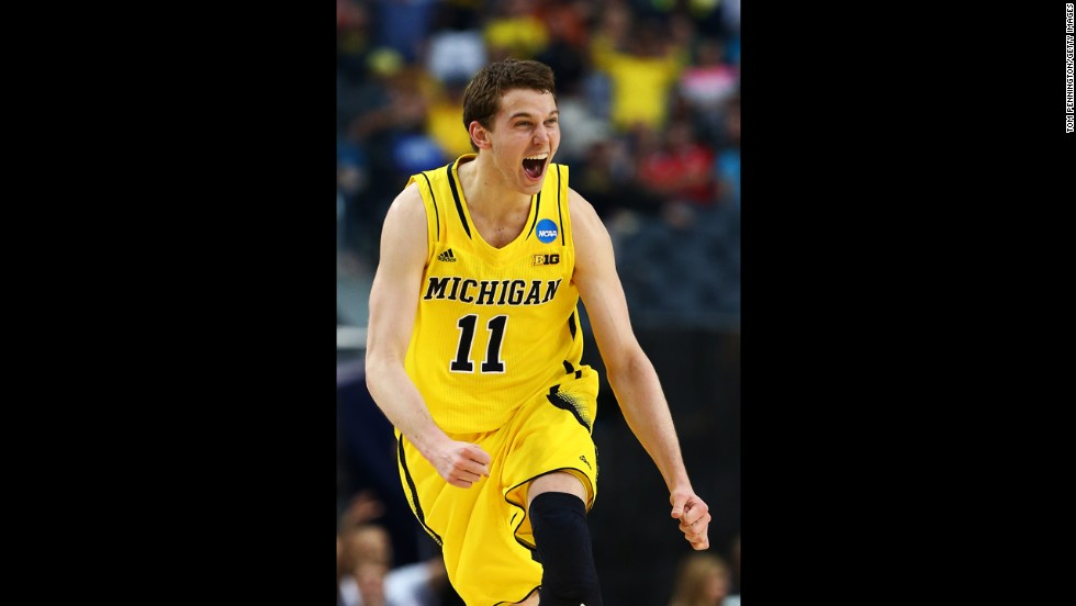 Nik Stauskas of Michigan celebrates after shooting a three-pointer.
