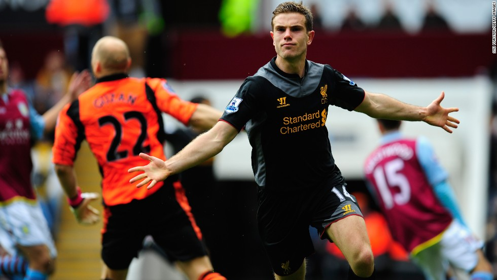 Jordan Henderson celebrates after scoring Liverpool's equalizing goal, having been set free by January signing Philippe Coutinho before chipping over Villa keeper Brad Guzan.
