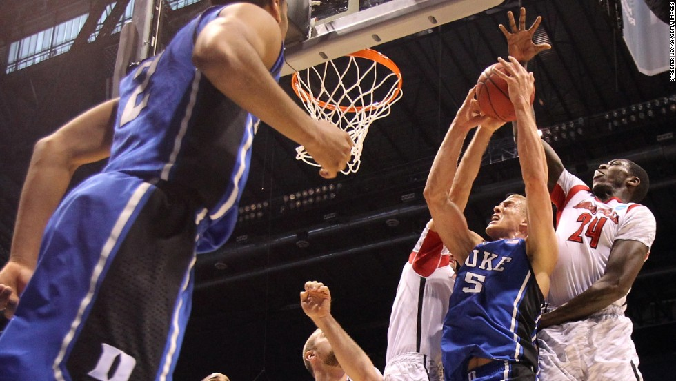 Mason Plumlee of Duke attempts a shot against Montrezl Harrell of Louisville on March 31.