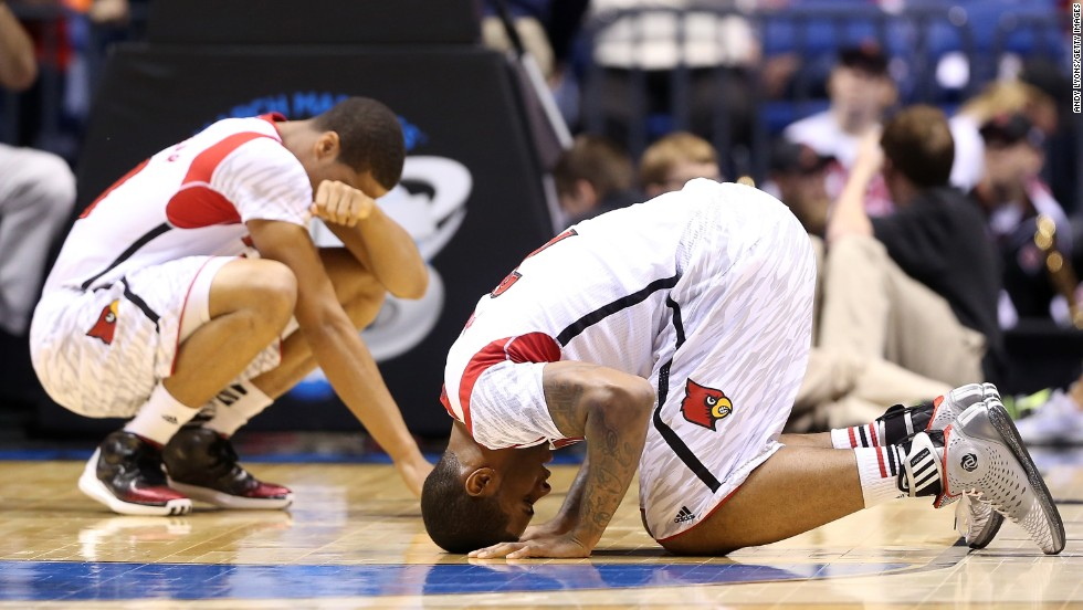 Wayne Blackshear, left, and Chane Behanan of Louisville react after Kevin Ware suffered a compound fracture to his leg in the first half.
