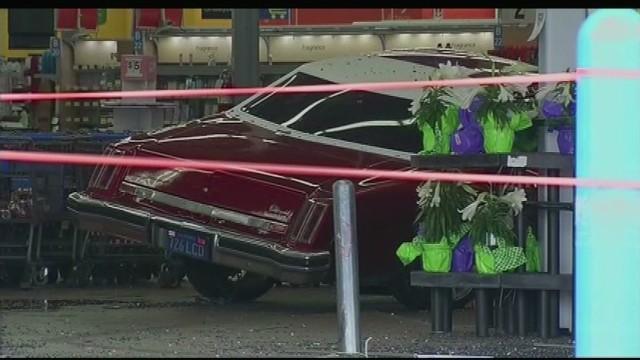 Car plows through Walmart doors