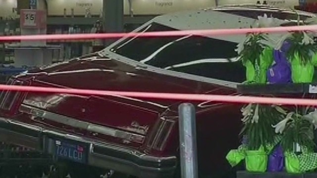 Man drives car into Walmart storefront