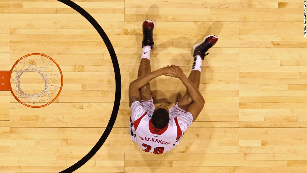 Wayne Blackshear of the Louisville Cardinals sits dejected under the basket.