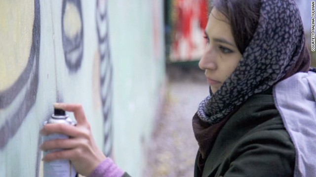 Graffiti artist defies Taliban threats