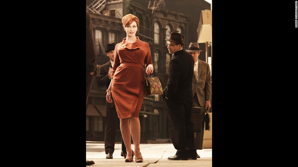 "It's hard not to think of 1960s office attire without conjuring images of the flawlessly tailored cast of ""Mad Men."" Here, actress Christina Hendricks' hourglass figure is emphasized with a streamlined dress fitted to perfection. ""In the 1960s you have a continuation of the 1950s tailored look -- but breaking it up with more color,"" said Arnold."