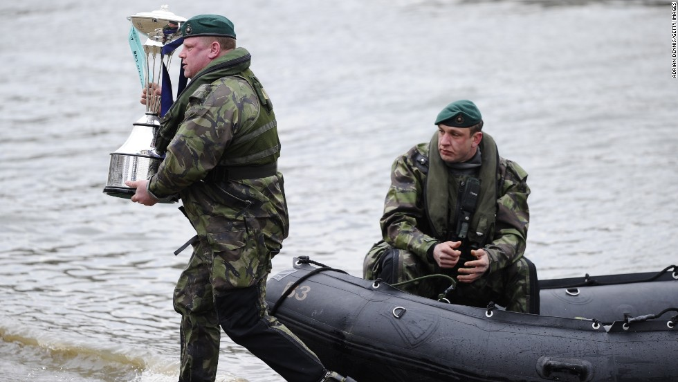 The British Royal Marines (pictured delivering the trophy) weren't taking any chances this year, patrolling the course armed with thermal imaging equipment.