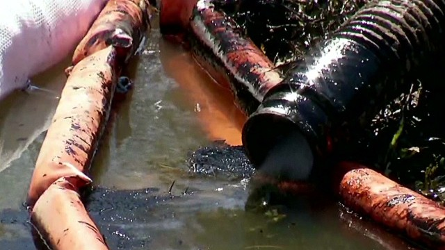 Oil pipeline bursts in subdivision