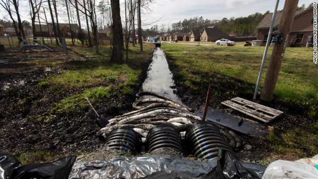 Canadian crude from an Exxon Mobile pipeline fills a ditch near evacuated homes in Mayflower, Arkansas, in 2012.