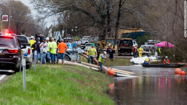 Emergency crews work to clean up an oil spill in Mayflower, Arkansas, on March 31.
