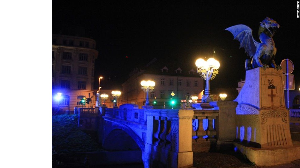The Dragon Bridge in Ljubljana, Slovenia, is illuminated to commemorate World Autism Awareness Day in 2012.