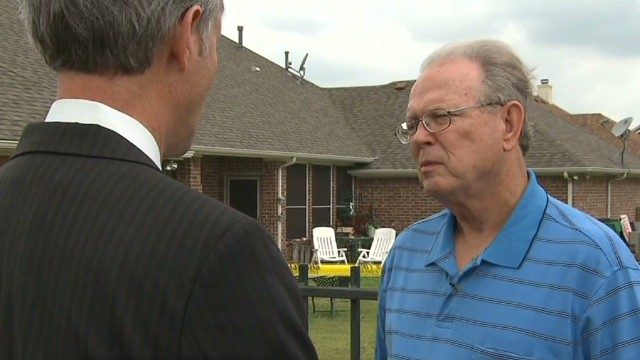 Neighbor didn't hear D.A. and wife shot