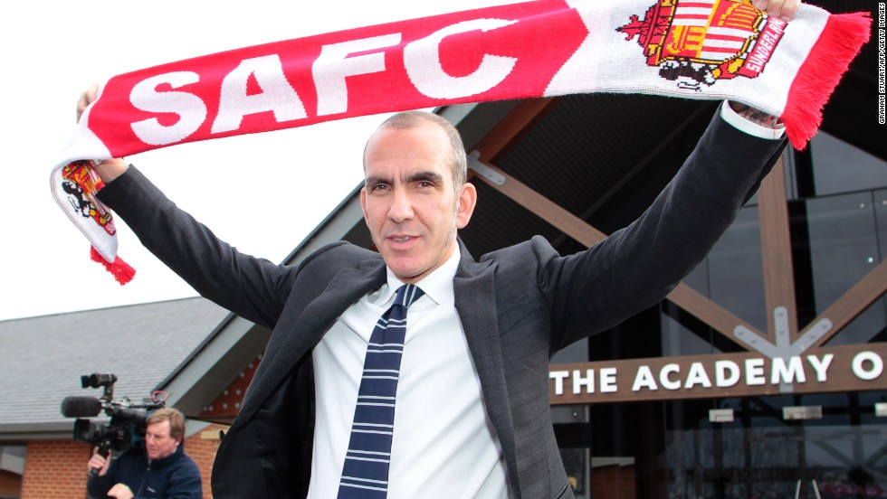 Paolo Di Canio poses after a press conference to unveil him as the new manager of English Premier League club Sunderland.