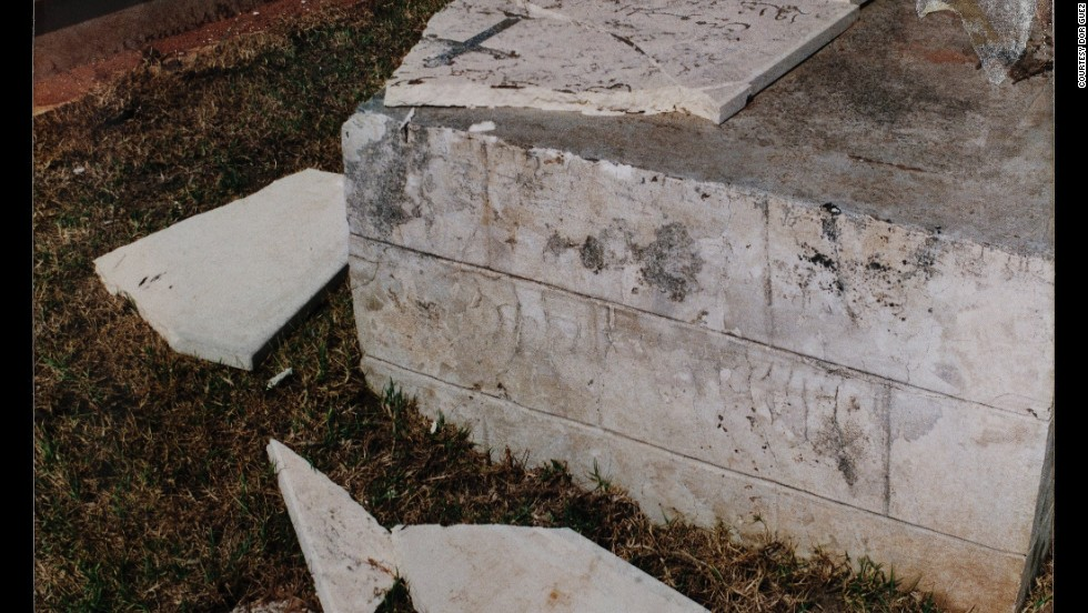 A damaged grave in a Christian cemetery in the town of Lod, Israel, depicted by Dor Guez. Guez says the city has been home to a Christian community since the 4th century, but after the town was claimed by Israel in 1948, all but about 1,000 Palestinians were expelled.