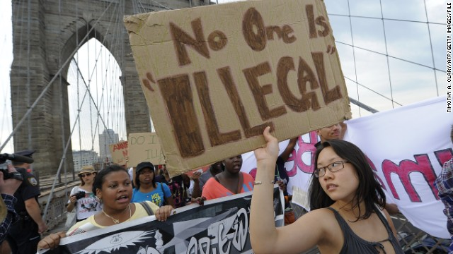 Protesters march across New York's Brooklyn Bridge in July 2010 seeking the repeal of an Arizona immigration law.