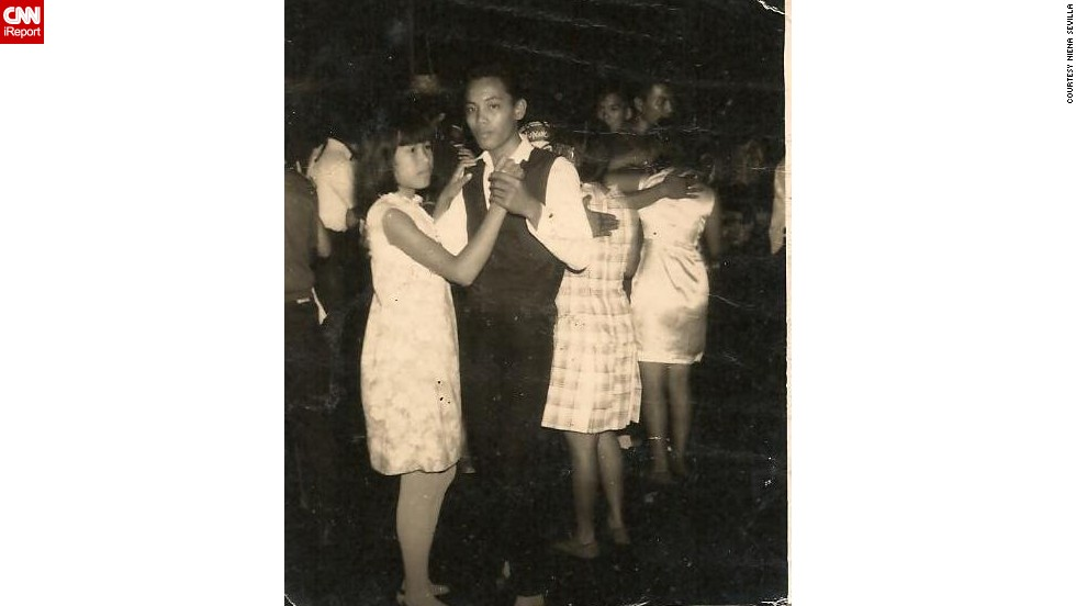 "<a href=""http://ireport.cnn.com/docs/DOC-948028"">Niena Sevilla's father</a> attended a New Year's Eve party in the Philippines in 1968. Her dad, 18 years old at the time, danced with one of the partygoers he met at the event. ""Women of the '60's were so natural,"" Sevilla says."
