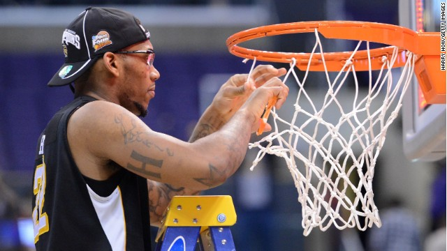 Wichita State's Carl Hall cuts down the net at Los Angeles' Staples Center after an upset win over Ohio State.
