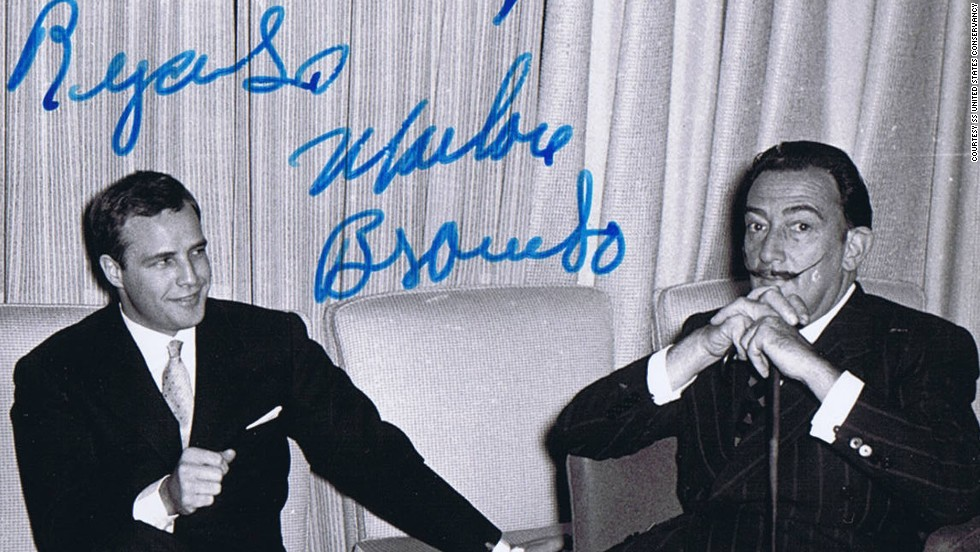 Actor Marlon Brando signed this photo of himself aboard the ship with artist Salvador Dali.