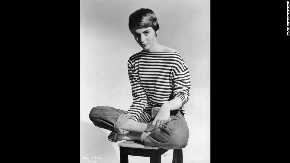 American actress Jean Seberg (1938-1979) helped popularize rolled-up blue jeans and French-striped sailor jerseys in the United States. The look became synonymous with tomboy style.