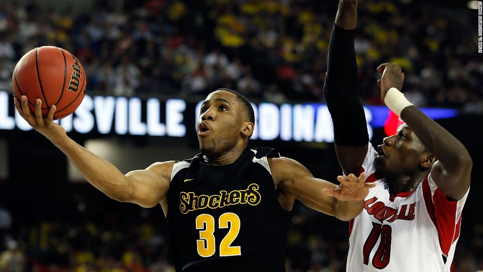 Tekele Cotton of the Wichita State Shockers goes up for a shot against Gorgui Dieng of the Louisville Cardinals.
