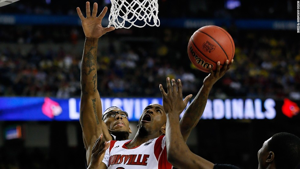 Russ Smith of Louisville attempts a layup.