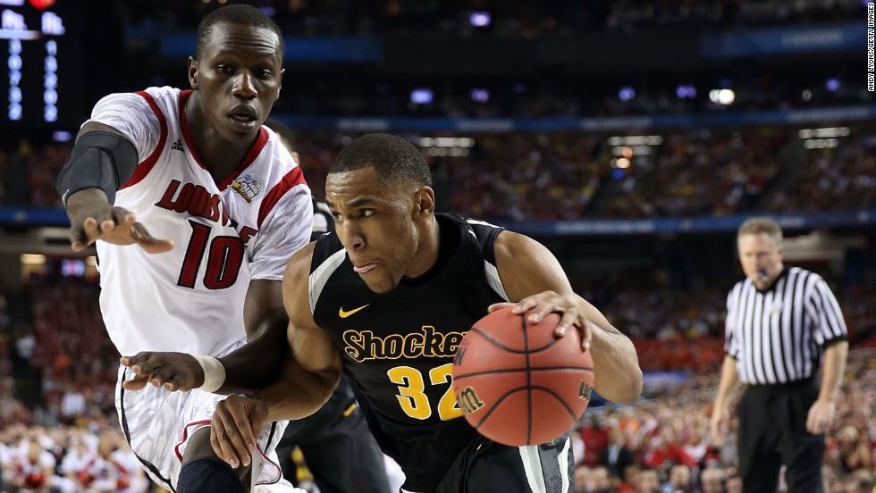 Tekele Cotton of Wichita State drives against Gorgui Dieng of Louisville.
