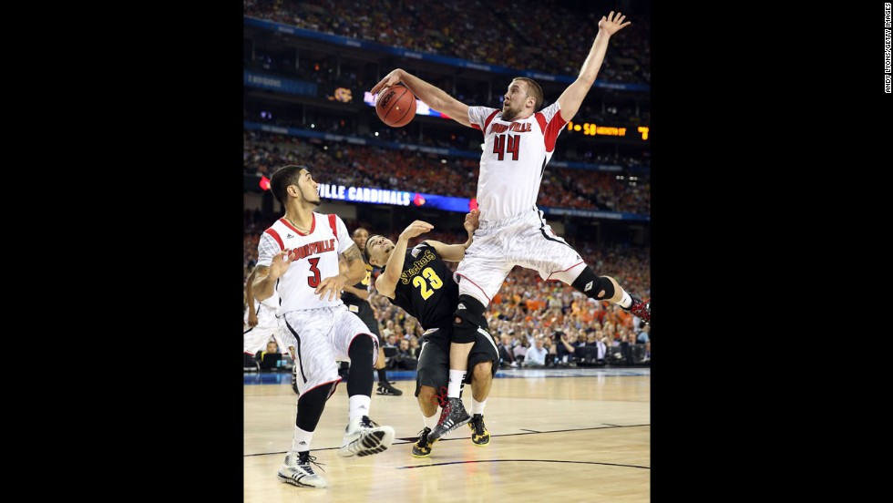 Stephan Van Treese of Louisville blocks a shot against Fred VanVleet of Wichita State.